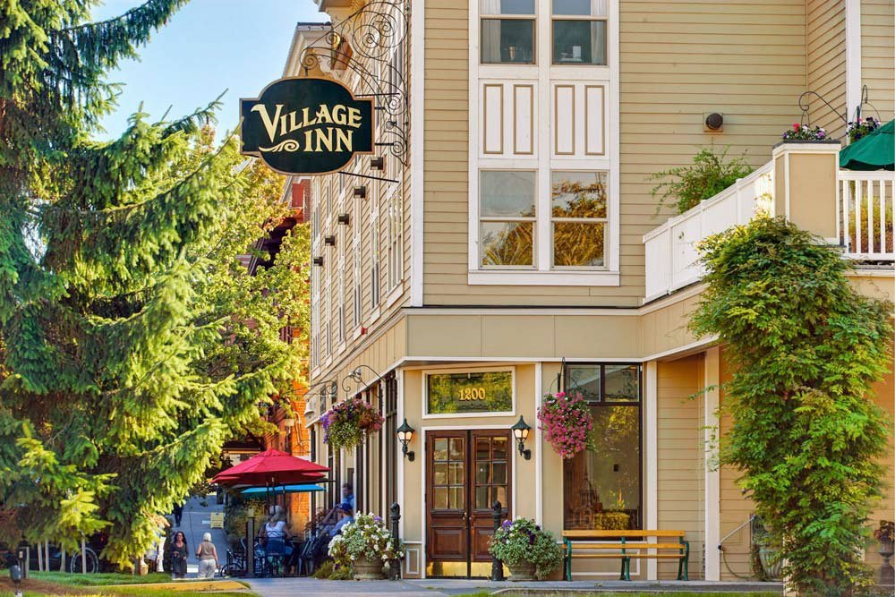 The outside of the Fairhaven Village Inn during summer.