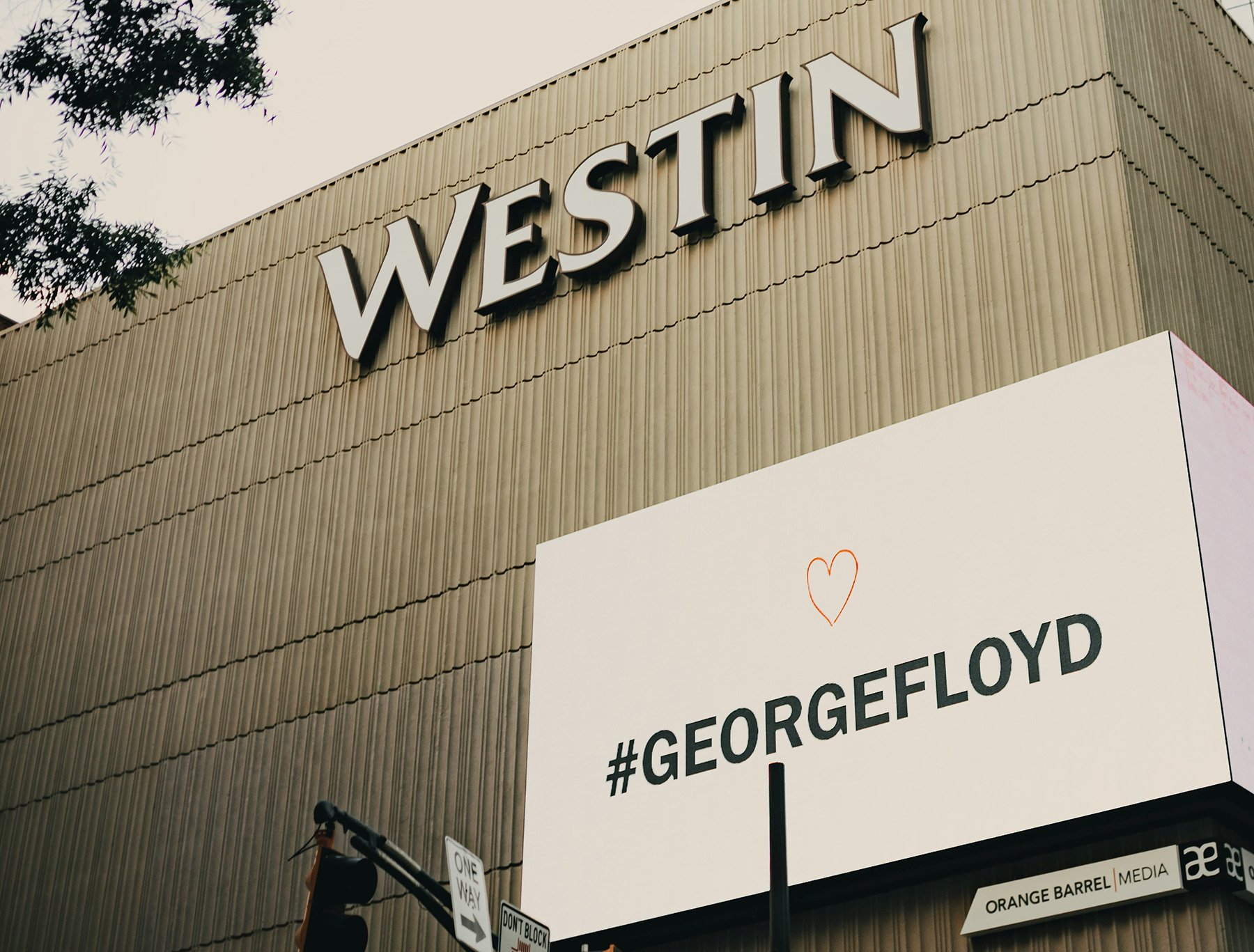 A Westin hotel shows a sign with a #GeorgeFloyd hashtag.