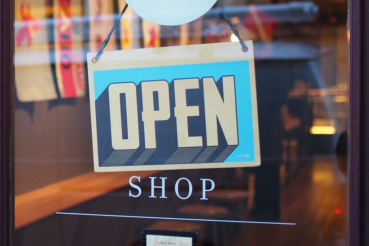 "An ""open"" sign in a shop window"